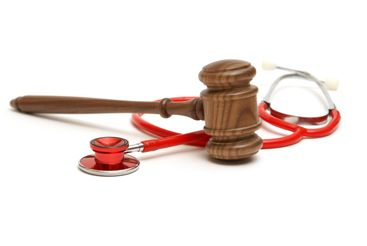 Wooden gavel and stethoscope representing medical lawsuit