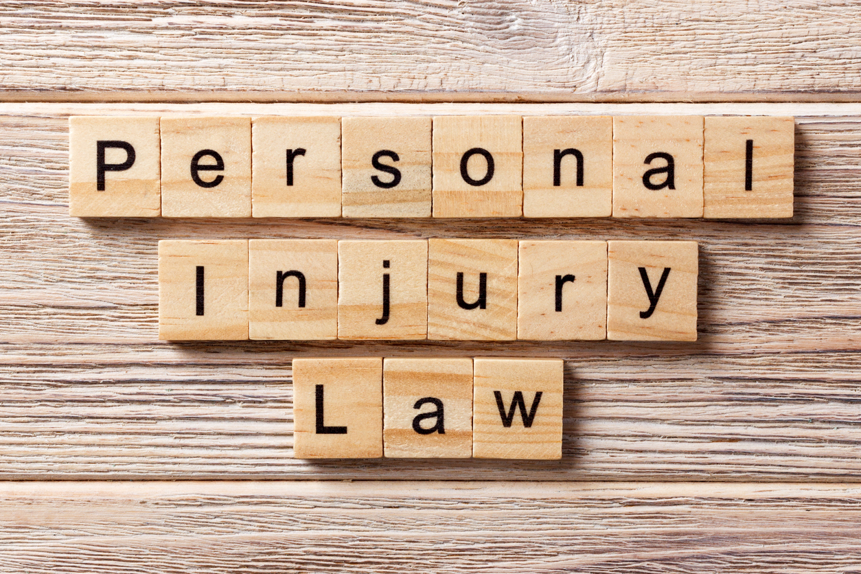personal injury law word written on wood block. personal injury law text on table, concept
