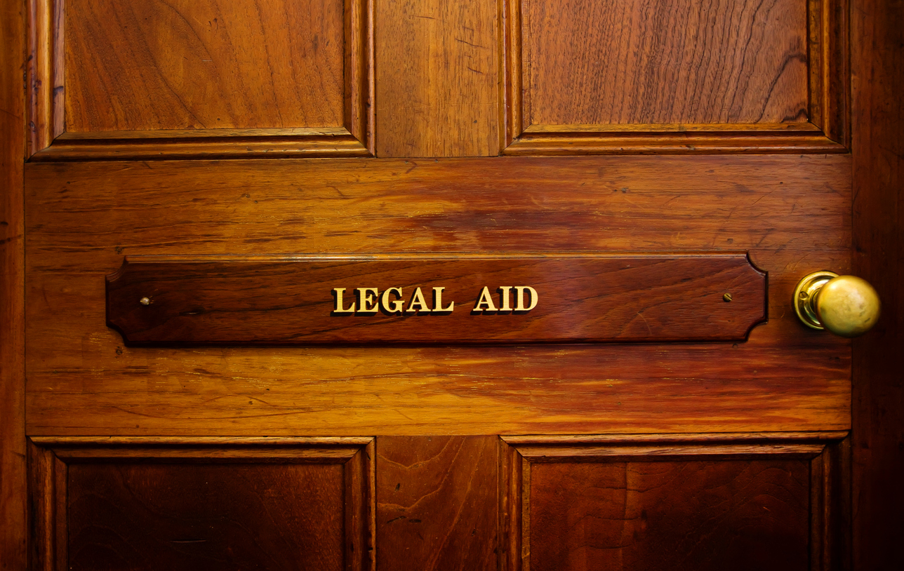 Legal aid sign on door