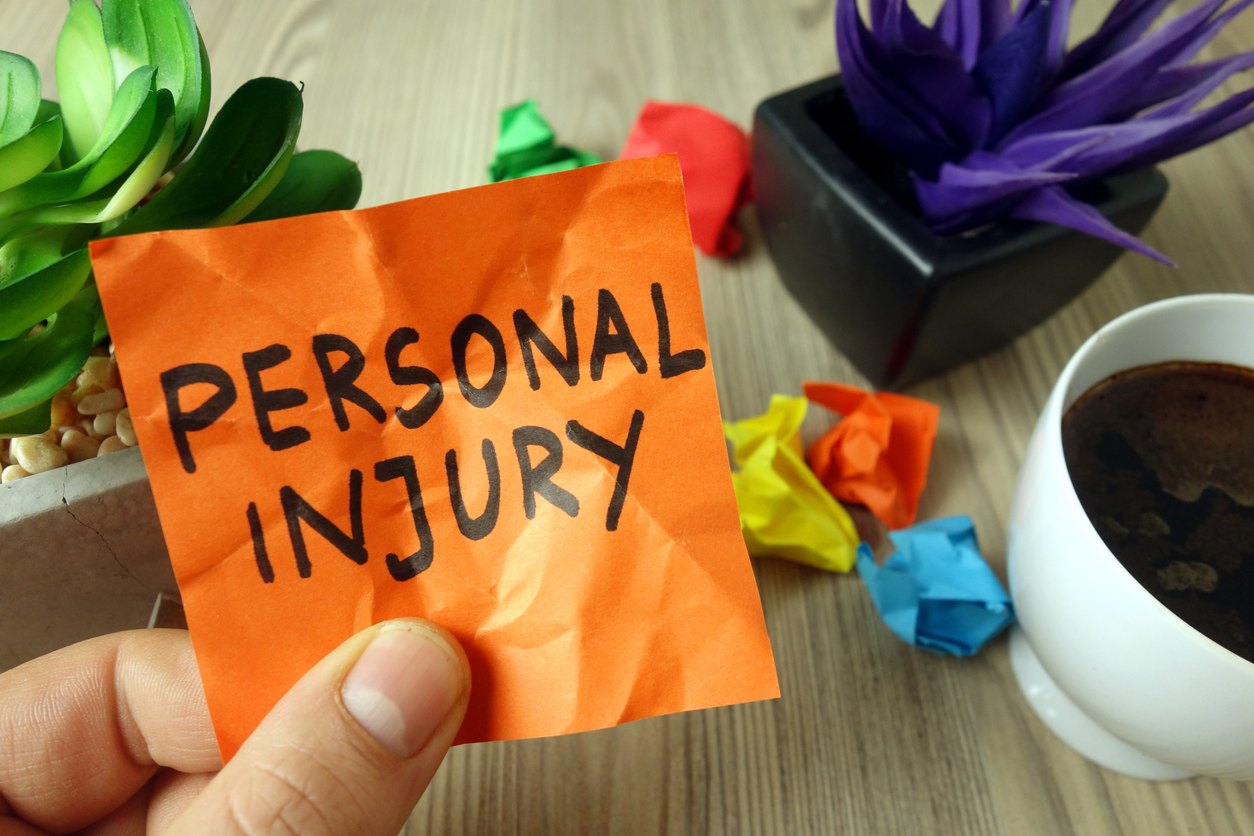 Text personal injury handwritten on sticky note