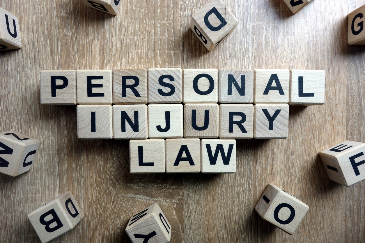 Personal injury law text from wooden blocks