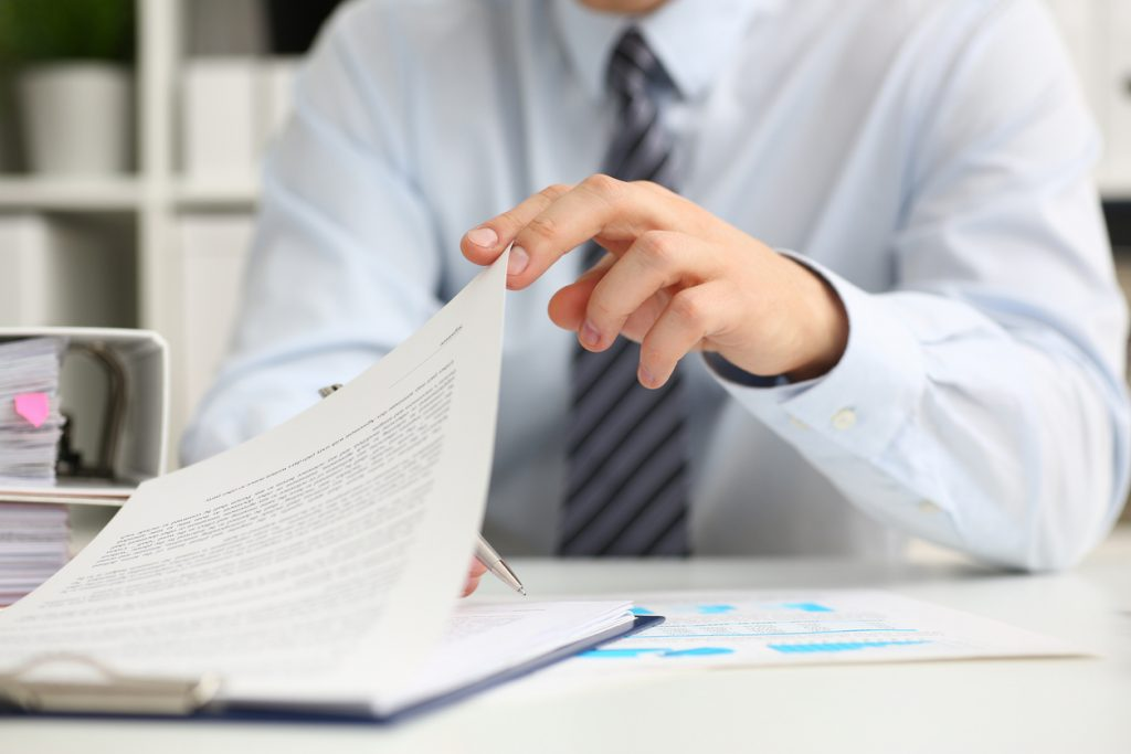 Male hands hold documents with financial